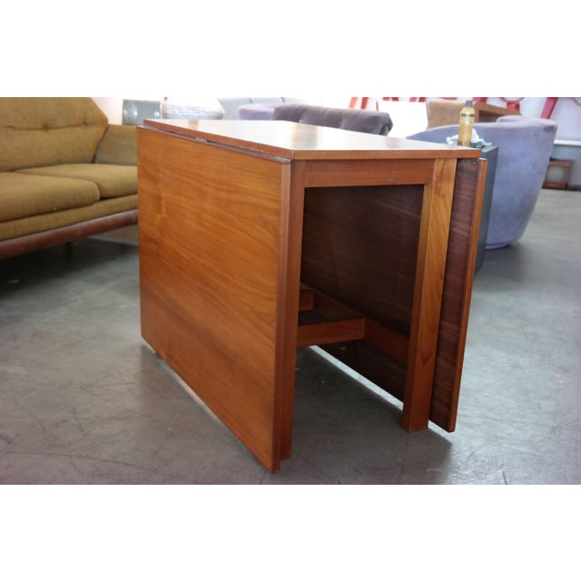 Danish modern teak gate leg drop leaf dining table in good condition, solid teak base and some cosmetic scratches and...