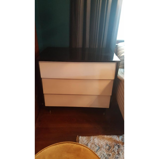 Vintage black and white 3 drawer chest of drawers by Florence Knoll. Black lacquer casing with white drawers. 2 available....