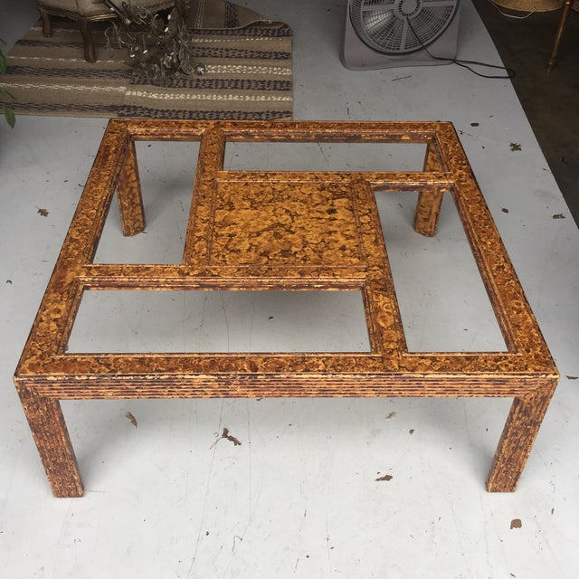 Gorgeous wooden table with tortoiseshell design.