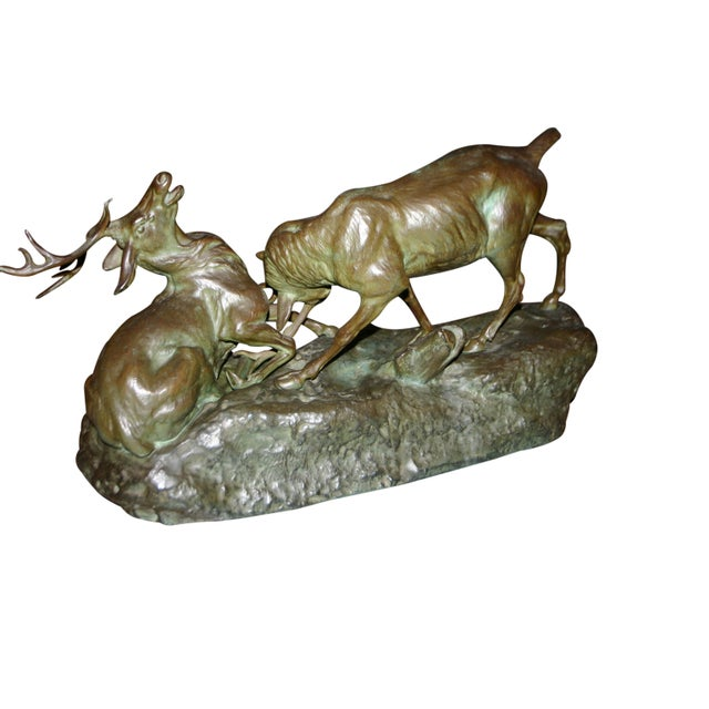 Authentic bronze by Thomas Cartier. An intense and dramatic sculpture capturing fighting stags with incredible, beautiful...