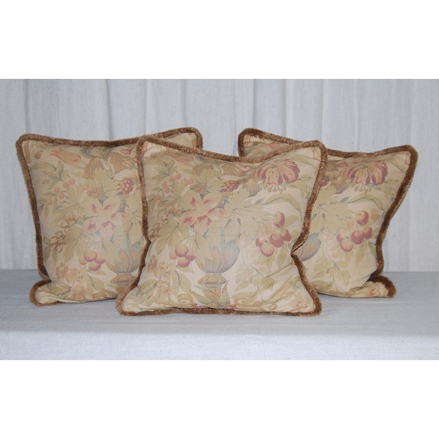 """Three vintage Bennison fabric pillows, backed in velvet, trimmed with brush fringe. 17"""" square, filled with down and zippers."""
