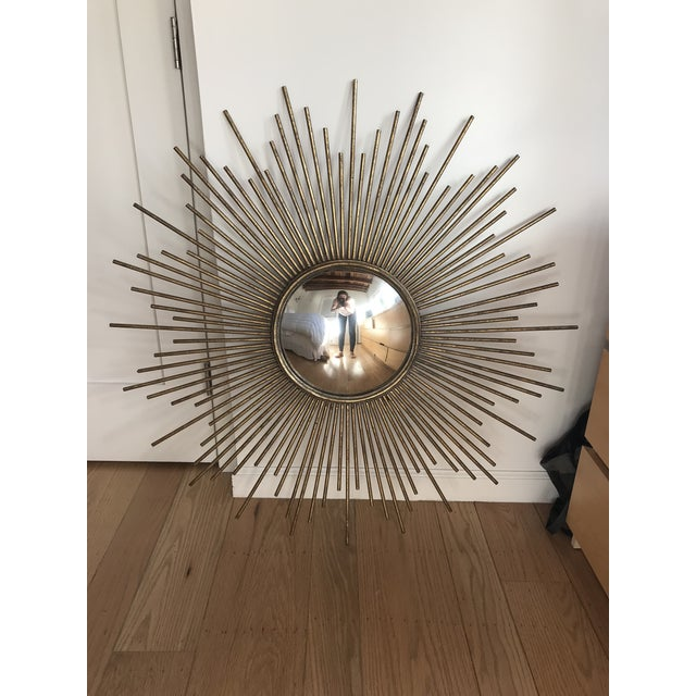 Mid-Century Modern style metal sunburst mirror. Aged gold/brass color has beautiful patina. A great accent piece in any...