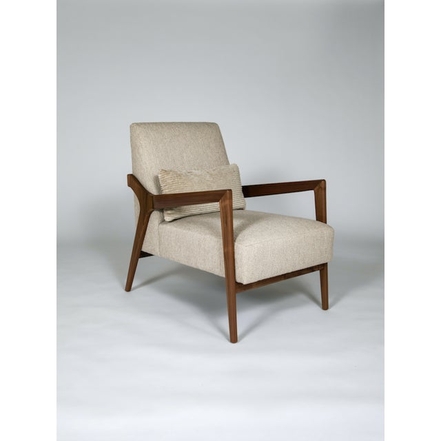 The Barney Club Chair by Studio Van den Akker is available in a variety of woods, stains and finishes as well as brass...