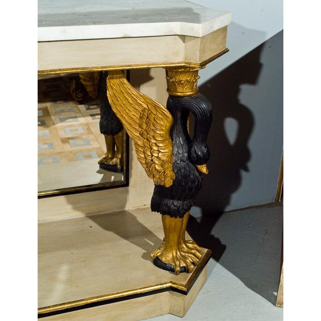 A fabulous French marble top console with gilded enhanced carved swans.