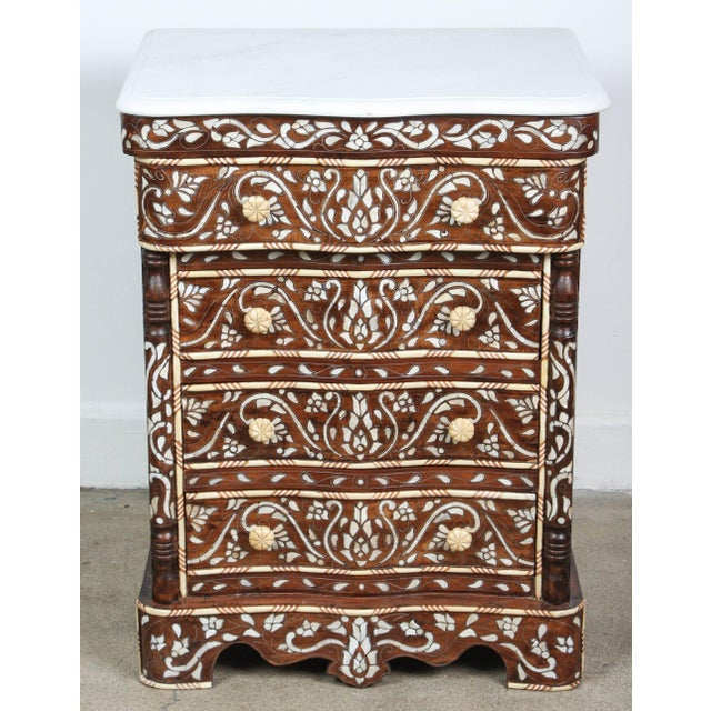 Fabulous pair of Middle Eastern Syrian mother-of-pearl inlay nightstands. Handcrafted wedding dresser with four drawers,...