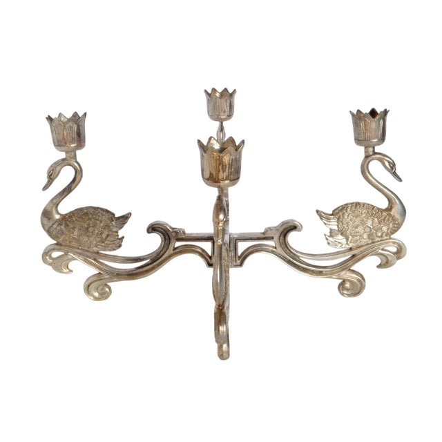 """A silver plated swan candle holder. A small bowl with a 3"""" dia. base can be placed in the center."""