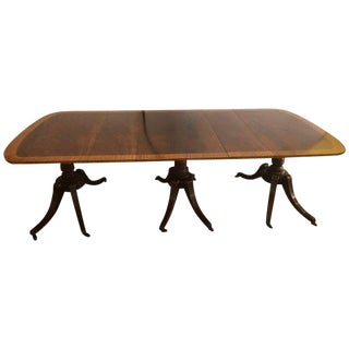 Georgian Style Crotch Mahogany Triple Pedestal Dining Table With Four Leaves For Sale
