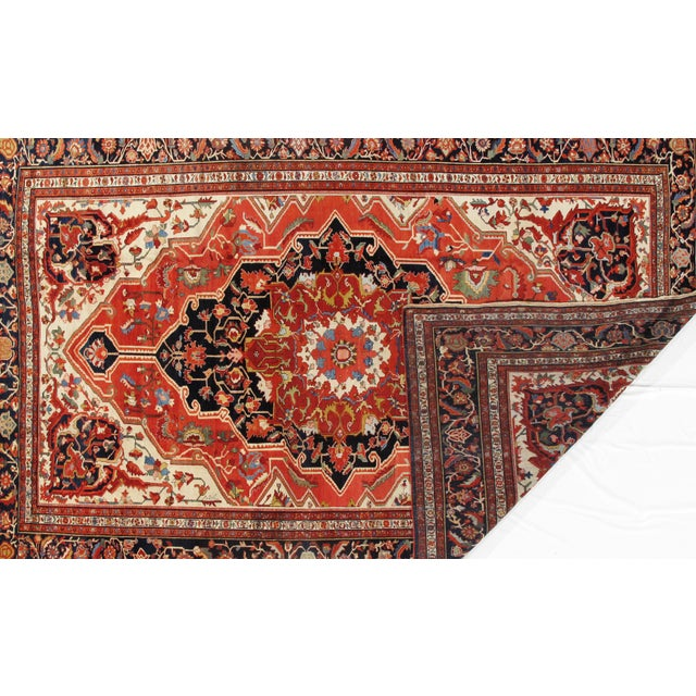 A hand knotted antique Sarouk Farahan rug. Hand-spun lamb's wool rug with all natural dyes.