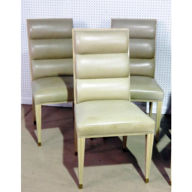 """Set of 6 mid century modern dining chairs with leather upholstery. 2 arm chairs measure 29""""h x 23.5""""w x 22""""d with a 20""""..."""