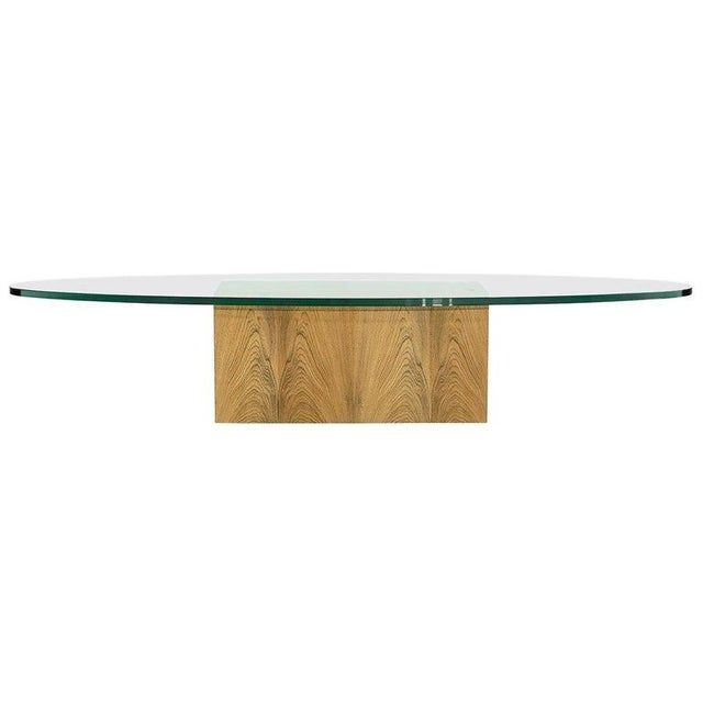 Rare coffee table designed by Harvey Probber, circa 1950s. New 1 inch thick glass top, bleached rosewood base fully...