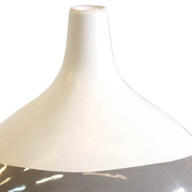 Contemporary ceramic bowling pin shaped gray and white vase. Would look great on a mantle or coffee table.