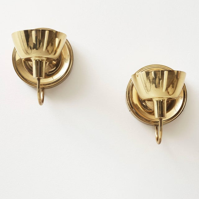 A pair of large wall lights designed by Josef Frank for Firma Svenskt Tenn, model 2389. Polished brass. Single, Edison...