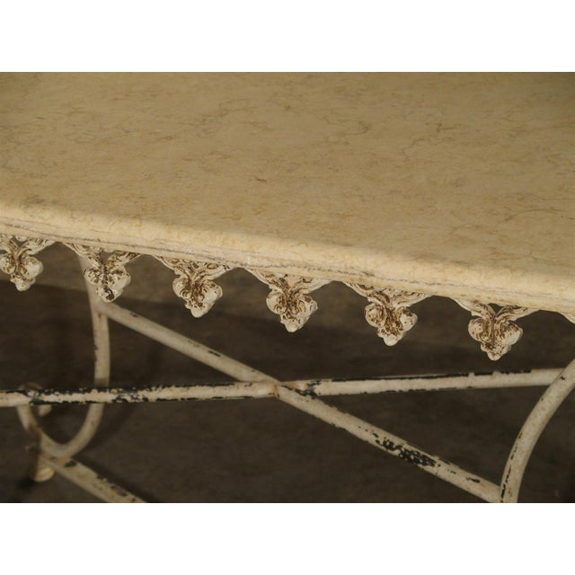This beautiful marble topped table has a cast iron base with a bronze center finial. Tables such as this were used in...