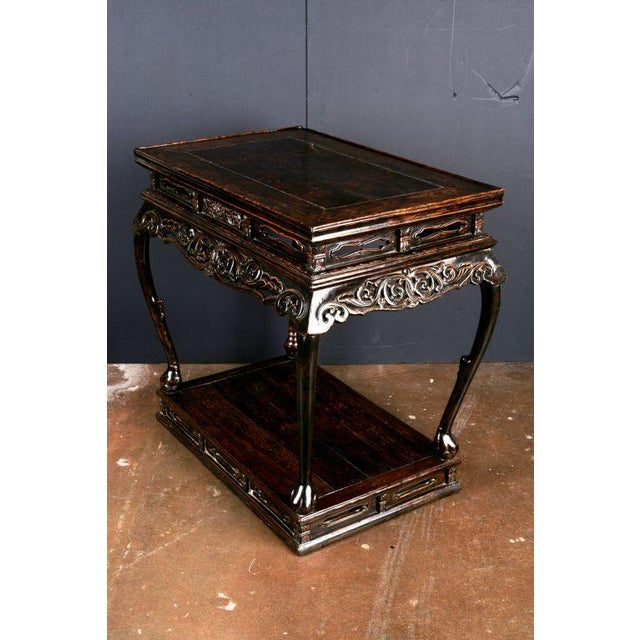 An elegant and graceful cabriole legged, high waisted altar table with scrolling apron, set upon a waisted platform. The...