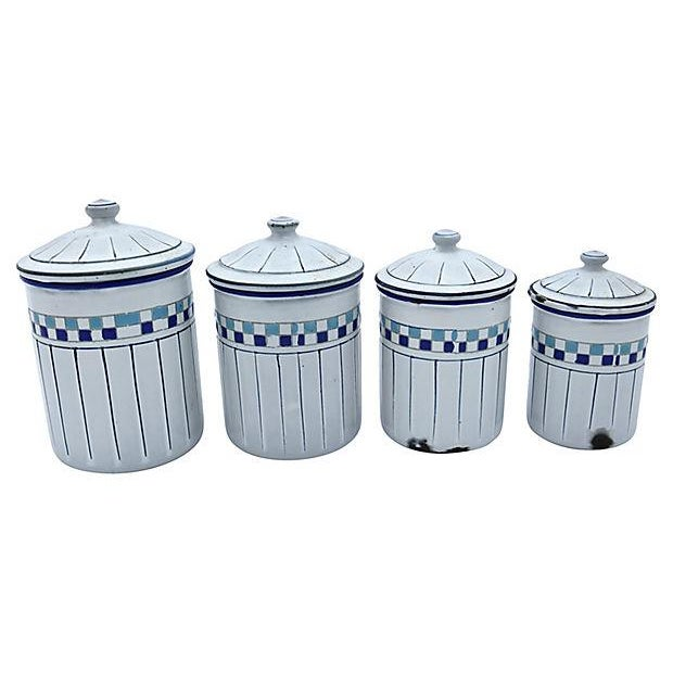 "Set of four French kitchen canisters. Maker's mark on bottom. Dimensions: sizes range from largest, 4.25""Dia x 6.5""H to..."