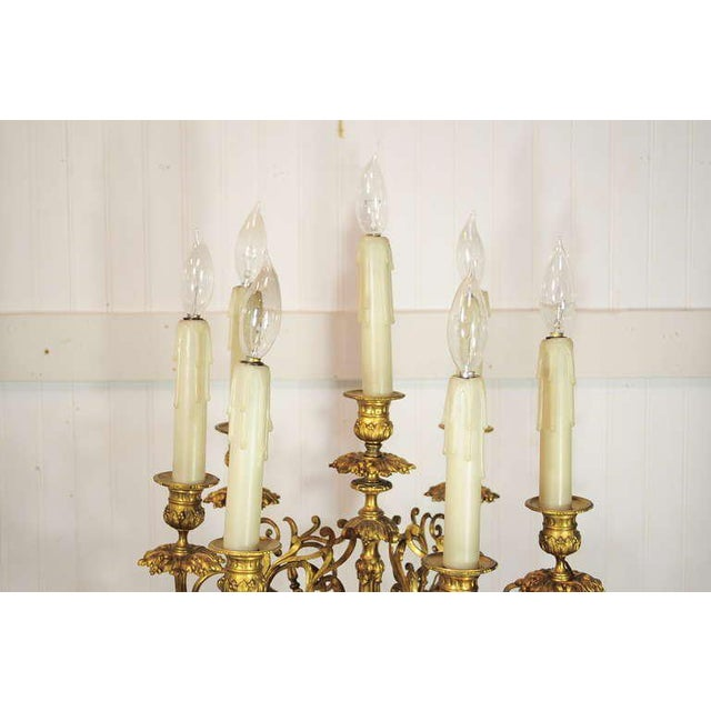 This is a stately French gilt bronze candelabra lamp in the Louis XV style. This remarkable table lamp features seven...