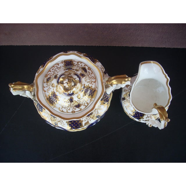 """Fine English soft paste porcelain decorated in cobalt and bright gold in the """"Buckle"""" pattern; Grande Baroque style; made..."""