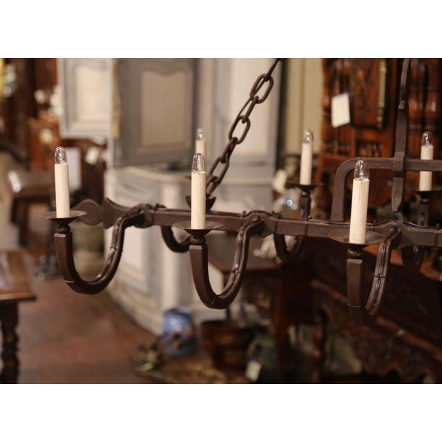 Decorate a game room with this rustic iron antique light fixture. Forged in France, circa 1900, the elegant Gothic...
