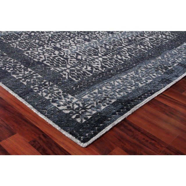 The Buckingham rug, with a modern update on the classic diamond pattern brings a touch of eclectic modernity. Hand Knotted...