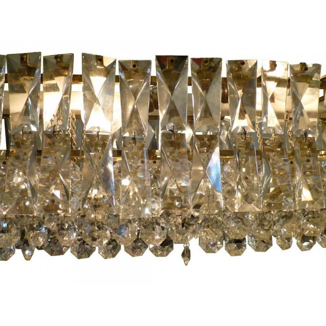 An excellent example of J. & L. Lobmeyr's finest work in brass and crystal lighting. This chandelier exhibits the firm's...