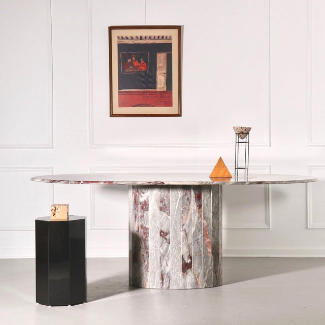 Oval pedestal dining table with fluted base. Gorgeous grey and pink marble referred to as salome marble. 1970's. Statement...