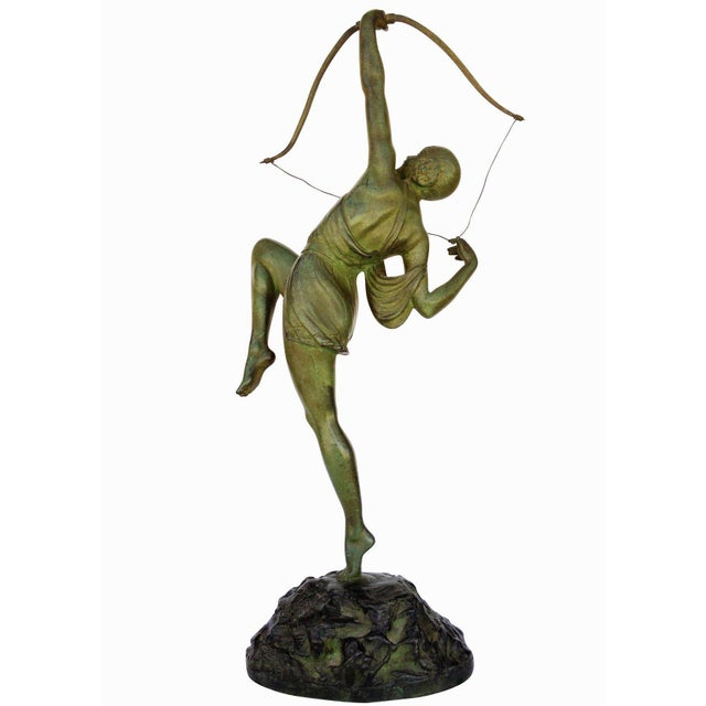 Designed by French sculptor Pierre Le Faguays, circa 1925, this Art Deco bronze statue features a young Grecian female...