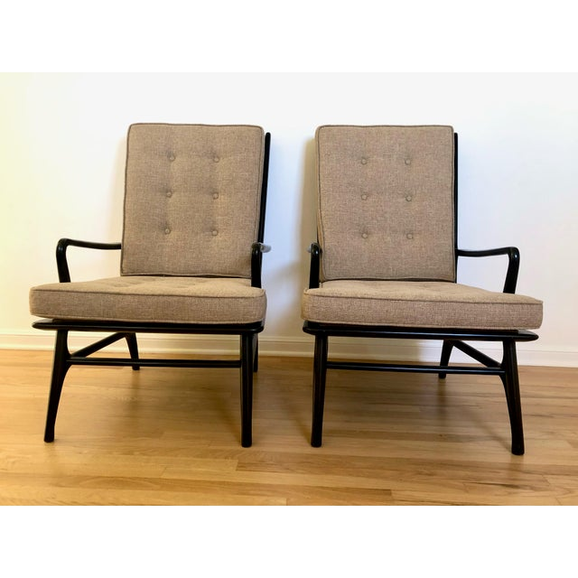 Pair of handsome black painted midcentury spindle back chairs in a Scandinavian Modern or Danish modern style. These...