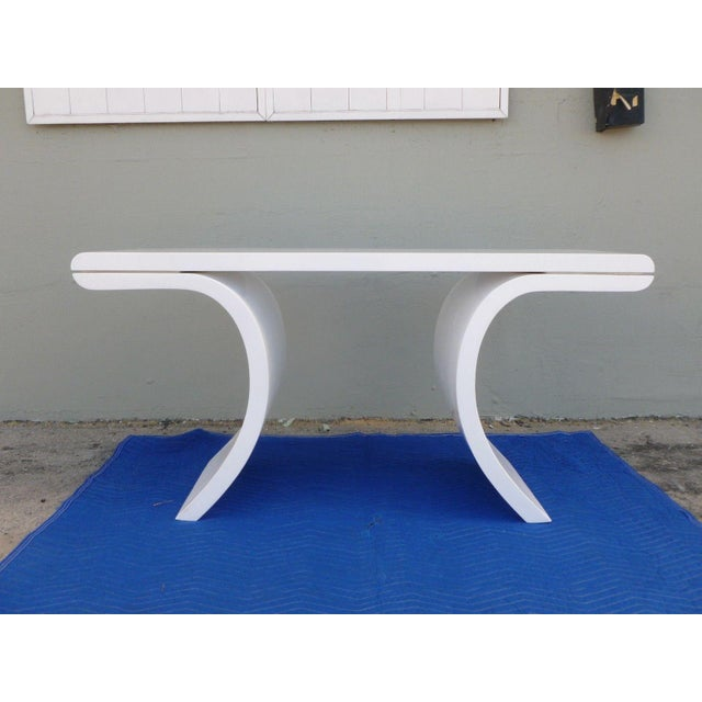Stunning 70's white lacquer Karl Springer inspired console table sold as found in vintage condition.