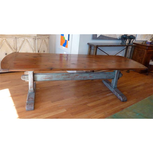 19th century Scandinavian trestle table. Molded pine top with shaped cleated ends over shaped and molded trestle base with...