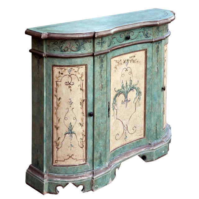 Hand painted green cabinet. This cabinet is a perfect statement piece for your home! It's hand painted and highlighted...