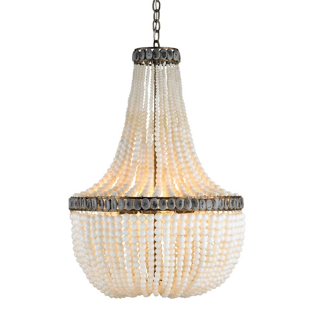 Glamorously fusing a traditional form with unexpected materials, the Hedy Cream Chandelier is fitted with strands of milky...