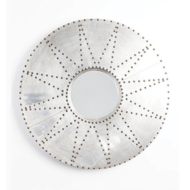 Large, stainless steel clad round mirror with brass studs.