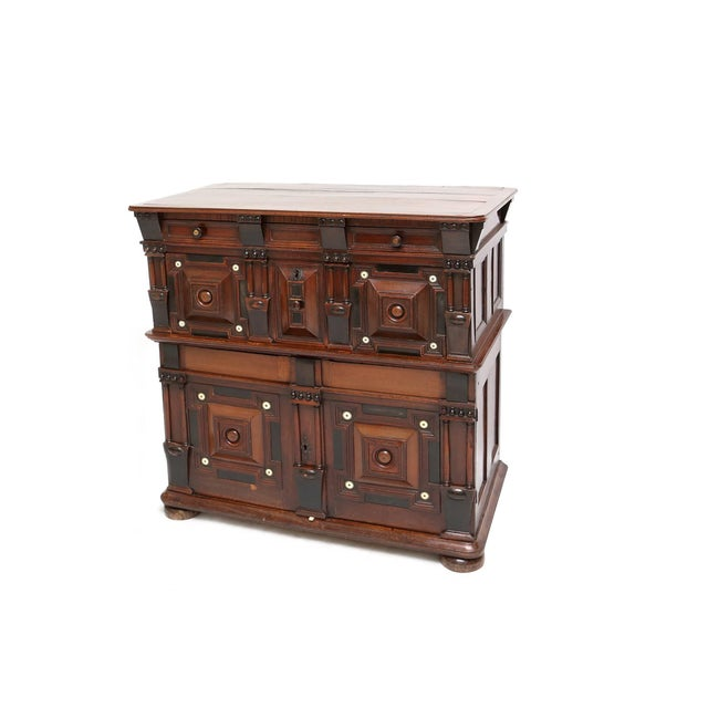 An amazing Flemish/William and Mary walnut, snakewood and ebonized cupboard chest. Inlaid with ivory roundels and with...