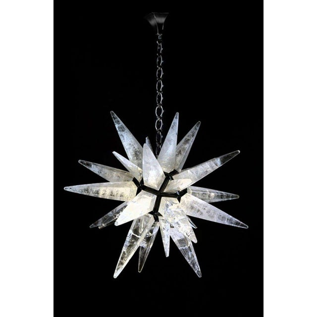 A spectacular rock crystal light fixture. The prisms on our fixture are cut from a single block of rock crystal that is...
