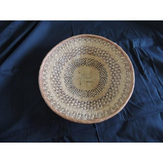 Large Tribal Round Woven Basket in Natural and Brown With Braided Rim Preview