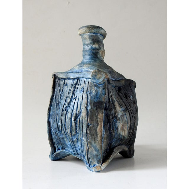 Abstract bottle form raku pottery with blue glaze. Signed illegibly on bottom. No chips or cracks, some spots without glaze.
