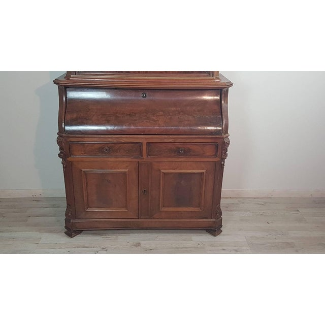 Elegant taffinato bookcase antique mahogany made in the mid-1800 century. Characterized by a high part with display...
