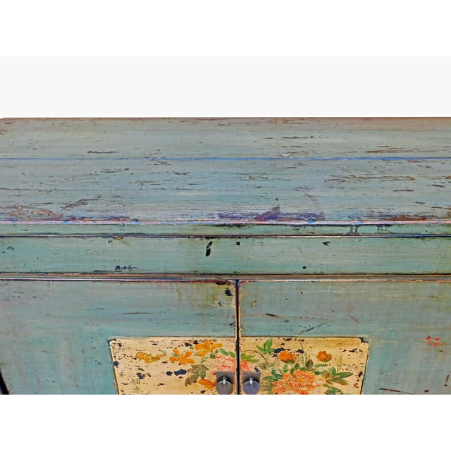 This is a side table-style cabinet with one door and a lift-up top. The surface is finished with rustic, blue-gray crackle...