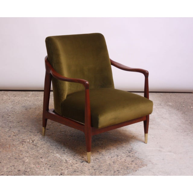 Exquisite, diminutive 1950s Italian lounge chair featuring a sculpted walnut frame and brass sabots. Newly reupholstered...