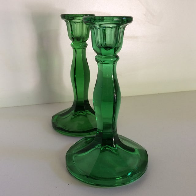 This is just a wonderful vintage Fostoria green and the candle sticks are in a traditional style. The base is thick and...