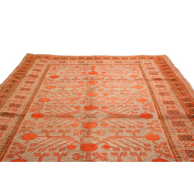 Originating from East Turkestan in 1920s, this antique Khotan rug features an all over field design, including meaningful...