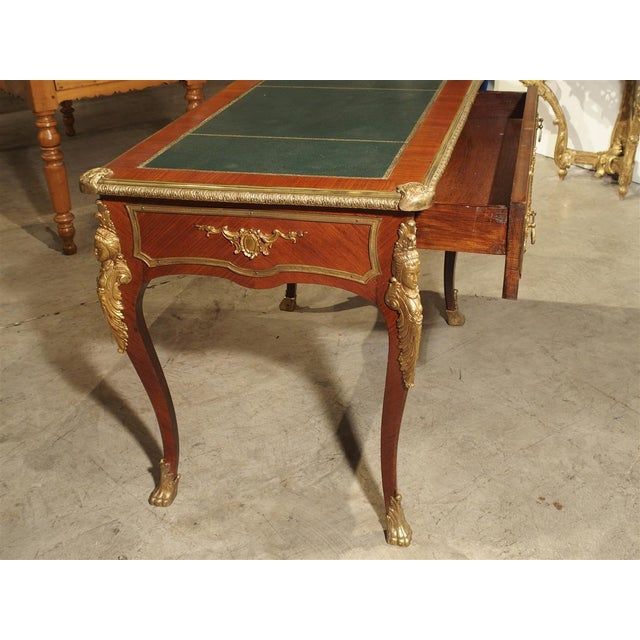 This Louis XV style Bureau Plat writing desk from France will be perfect in any room. It has veneered exotic wood, elegant...