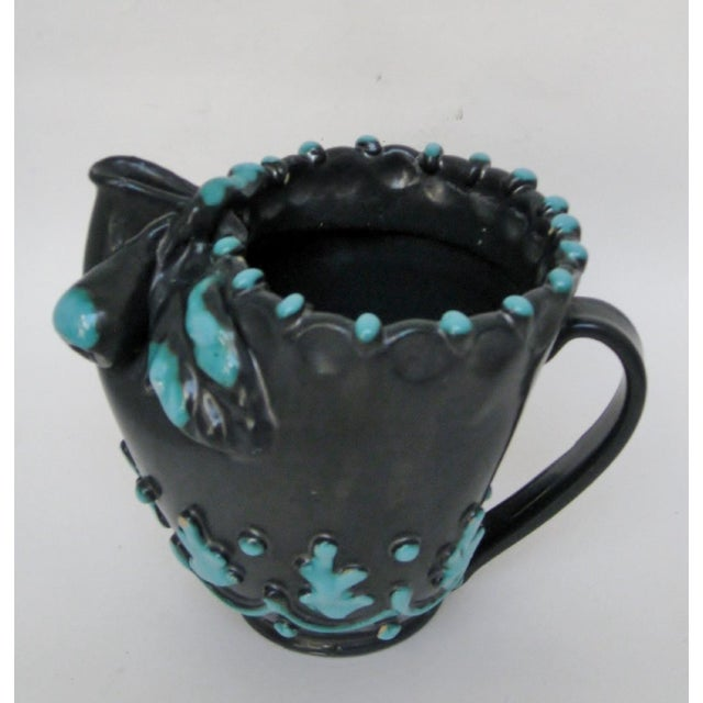 Italian 1950s dark charcoal satin glazed pitcher vase with embossed turquoise accents and majolica-style fig and leaf at...