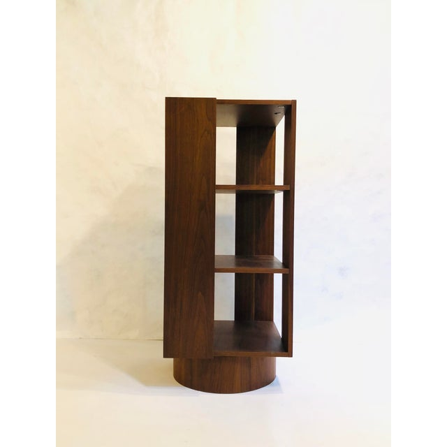 3 tier revolving walnut bookcase on round base.