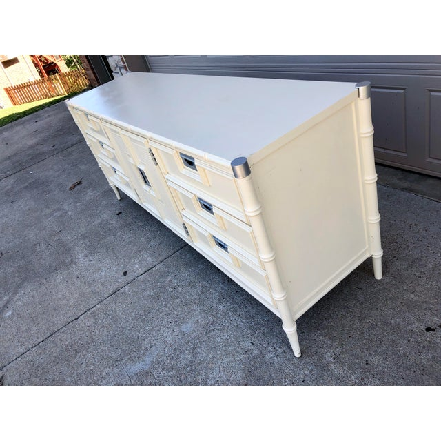 Vintage faux bamboo dresser by Stanley Furniture. This piece has been painted white and brass caps and hardware were...
