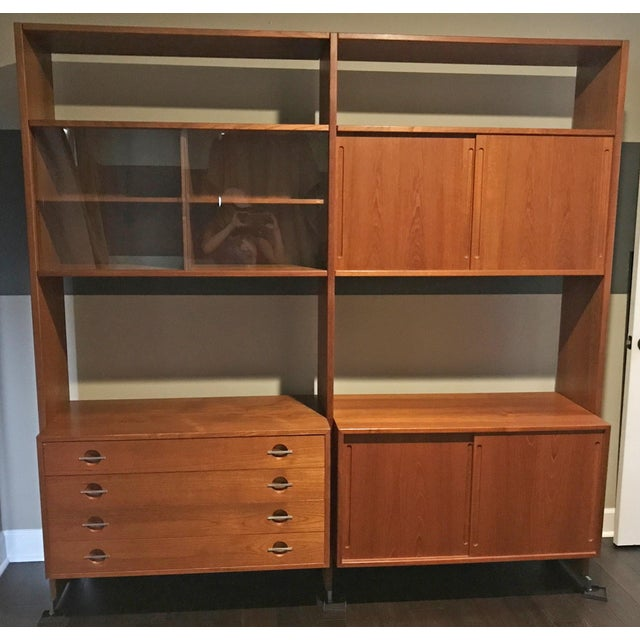 A stunning piece of Mid-Century Modern Danish design. This large teak wall unit is comprised of two large bays, with a...