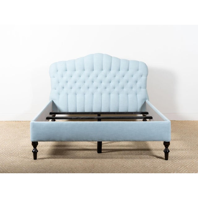 Upholstered queen bed with tufted headboard Fabric: Molino Seaside - 100% Organic Cotton Antique walnut wood finish