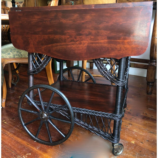 1890's Heywood Wakefield Victorian bar harbor wicker willow and wood drop leaf tea cart. In excellent condition with...