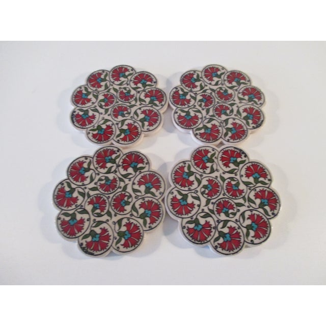Vintage Set of Four (4) Red and Green Carnations Turkish Ceramic Coasters Geometric design in shades of white, red and...