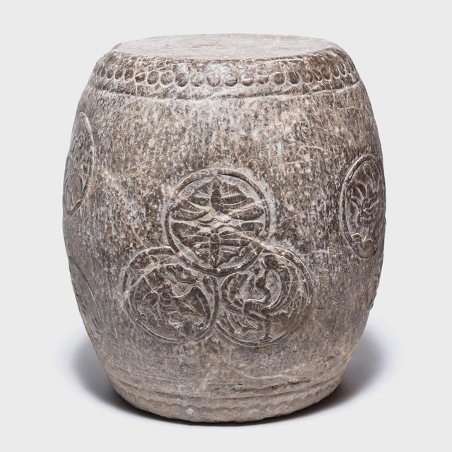 Circular charms adorn the graceful swell of this elegant stone drum stool. An encircled bat symbolizes happiness and joy,...